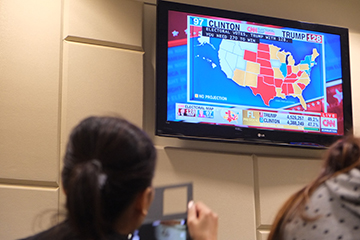 Photo by Nao Enomoto  More than 25 people turned out to watch the election coverage at the Dunseth Auditorium.