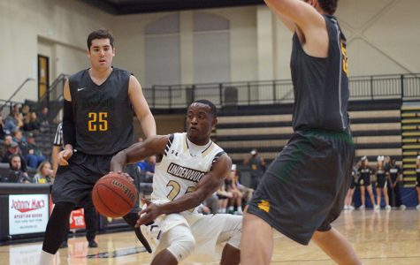Bakari Triggs attempts to split the Missouri Southern defenders and drive toward the hoop.<br>Photo by Phil Brahm</br>