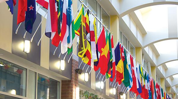 The atrium in Lindenwood's Evans Commons is lined with flags from around the world. There is a flag for each country represented in the university's student body.  Photo by Romane Donadini