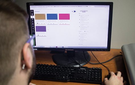 A student checks his Canvas dashboard for new assignments in his classes. <br> Photo Illustration by Kelby Lorenz