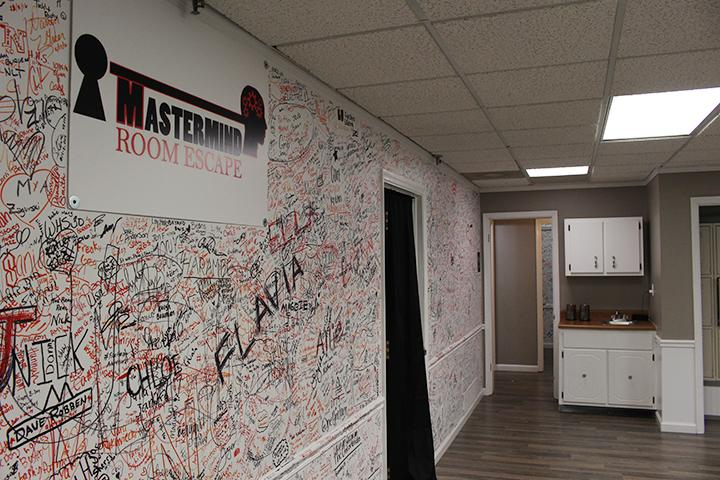Mastermind Room Escape has walls covered with the names of people who have escaped the rooms in 60 minutes or less.  Photo by Kyle Rainey
