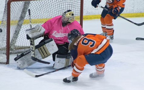 Sophomore Jolene deBruyn tends the net at the annual Pink the Rink game against Syracuse on Jan. 20 at the Lindenwood Ice Arena. The Lions lost the game 5-0. <br> Photo by Kelby Lorenz