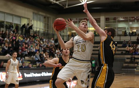 Chandler Diekvoss goes up for a layup against a Missouri Western defender in a conference game on Feb. 2. <br> Photo by Carly Fristoe