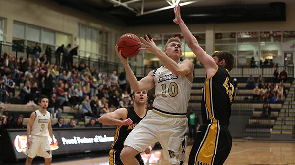 Chandler Diekvoss goes up for a layup against a Missouri Western defender in a conference game on Feb. 2.  Photo by Carly Fristoe
