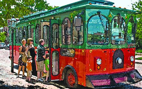 Trolley on Main Street picking up passengers on its route.<br> Photo from stcharlestrolley.com