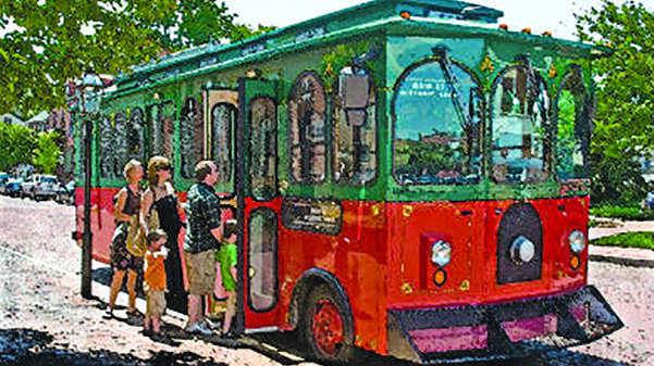 Trolley on Main Street picking up passengers on its route. Photo from stcharlestrolley.com
