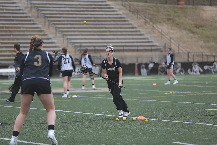 Senior+Sarah+Goetz+keeps+her+eye+on+the+ball+coming+to+her+from+sophomore+teammate+Sarah+Cromer+during+a+spring+practice+in+Hunter+Stadium.+++Photo+by+Carly+Fristoe