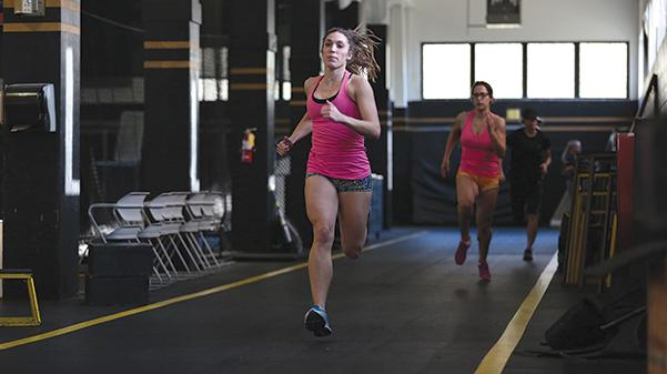 Track and field jumpers Kendra Smith and Joy Kanengiser train for the indoor season in the Lindenwood Field  House Feb. 16, 2017.  Photo by Carly Fristoe