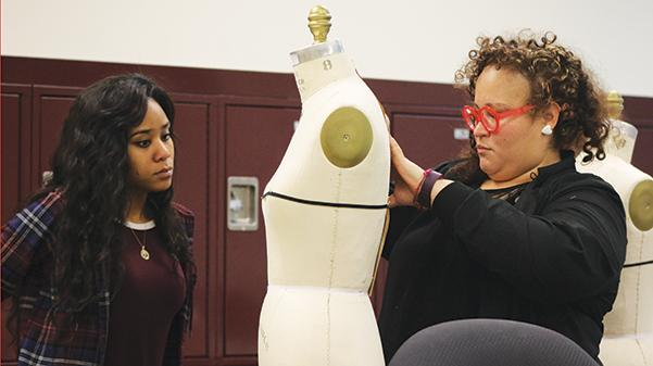 Nasheli Ortiz (right) works with Darielle Neely (left) on draping fabrics in a draping class on Jan. 26, in the J. Scheidegger Center.  Photo by Kelly Logan