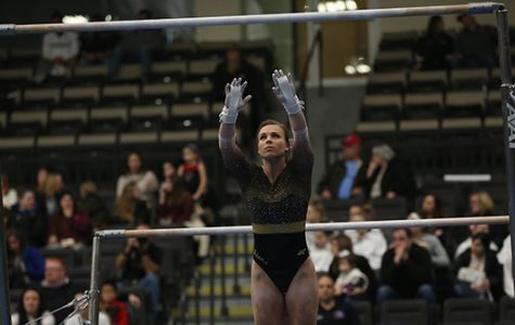 Kierstin Sokolowski competes in her bars routine in a Jan. 15 meet at Hyland Arena. <br>Photo by Carly Fristoe</br>