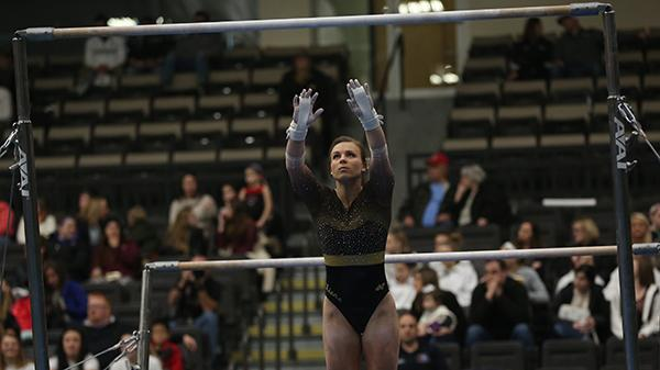 Kierstin Sokolowski competes in her bars routine in a Jan. 15 meet at Hyland Arena. Photo by Carly Fristoe
