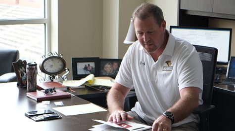 Stugart does some offseason work in his office located in the Student Athlete Academic Success Center.<br>Photo by Nao Enomoto