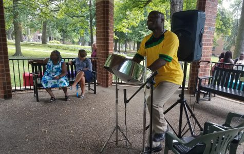 Nigel Thomas, musician of Steel Drum Flavor, plays the steel drum at Multicultural Monday on Aug. 28. Photo by Kayla Drake.