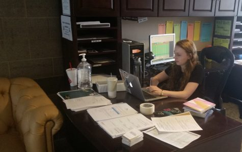 Community adviser Elizabeth Peters covers the front desk of Calvert Rogers on Aug. 30 during visitation hours. <br> Photo by Lindsey Fiala