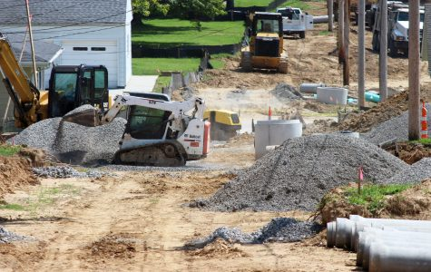 Construction crews are working on building an alleyway and parking spots behind campus homes.  Photo by Kyle Rainey