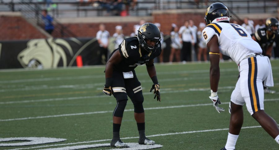 Lindenwood senior defensive back Bakari Triggs faces up against University of Central Oklahoma wide receiver Josh Crockett in their game at Lindenwood on Sept. 1, 2016.