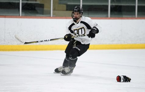 Men's ice hockey defender Austin Wilk at practice the day before this weekend's games. <br> Photo by Mitch Kraus