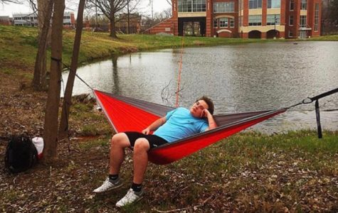 R.J. Dietrich, APO member, hammocks in front of the Student Athletic Center. <br> Photo from Hanna Wyland.