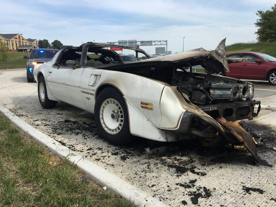 The white 1980 Pontiac Trans Am was steaming smoke at Fifth Street and Interstate 70 Monday afternoon around 3 p.m.  Photo by Ashley Higginbotham