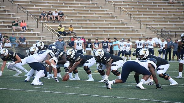 The Lions prepare to snap the ball during the Sept. 16 game against Washburn University. <br> Photo by Maria Escalona