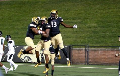 Justin Smith and two other Lindenwood Lions player jump into the air to celebrate a Lindenwood touchdown against Northeastern State University at Hunter Stadium on Sept. 7. Lindenwood won 49-10. <br> Photo by Lindenwood Athletics