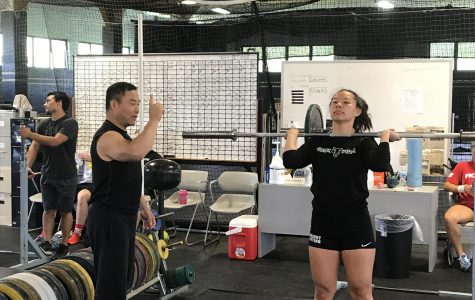Coach Jianping Ma instructing student before leaving for Michigan