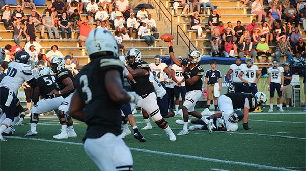 Lindenwood quarterback Najee Jackson passes the ball in Saturday's game against Washburn University at Hunter Stadium. Jackson had 17 complete passes for 196 yards, but Lindenwood lost 26-16. Photo by Maria Escalona.