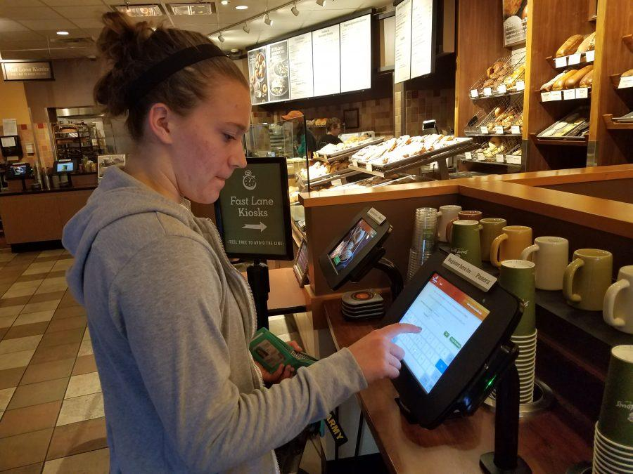 Sophomore+Ariana+Fischer+uses+the+self-checkout+counter+at+St.+Louis+Bread+Company.++Photo+by+Kayla+Drake+