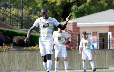 Steven Lilako, Men's MIAA soccer player of the week walks onto the field. <br> Photo by Lindenwood Athletics