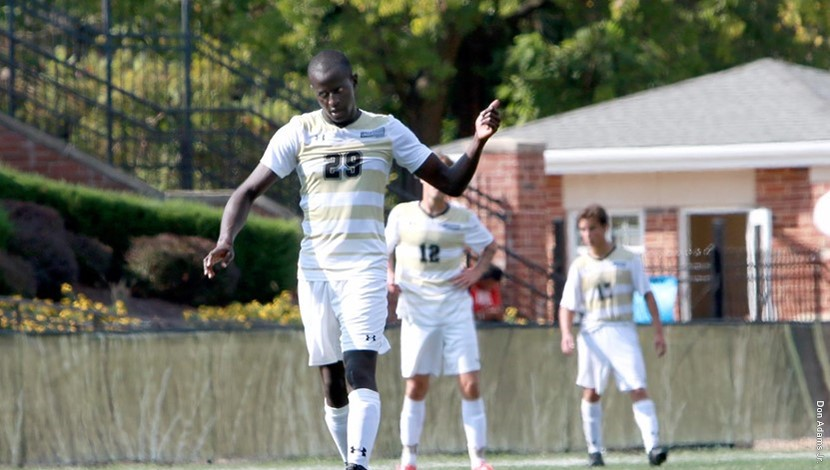 Steven Lilako, Men's MIAA soccer player of the week walks onto the field.  Photo by Lindenwood Athletics