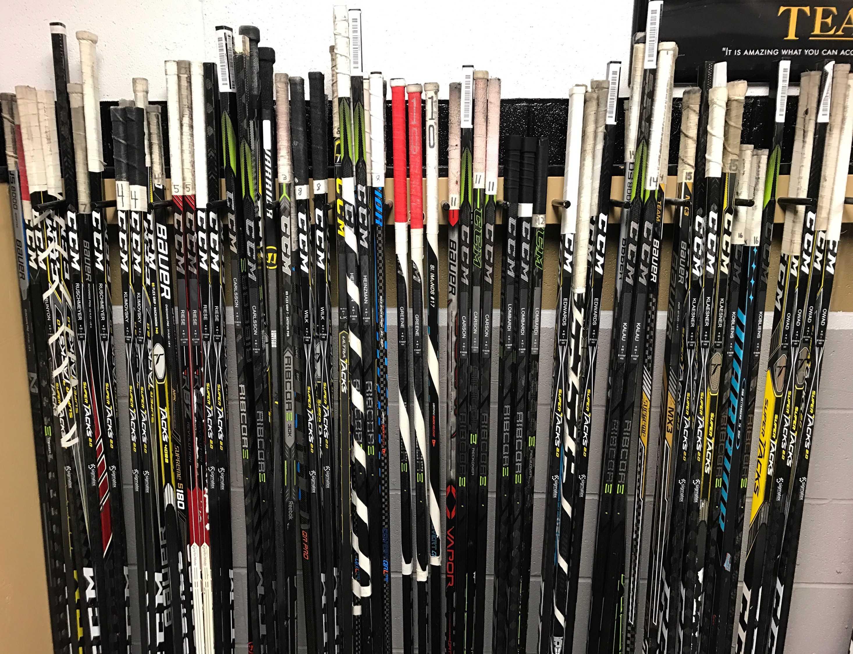 The men's hockey team have new hockey sticks for the season.  Photo by Alex Kalau.