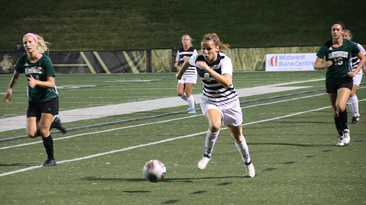 Sophomore+Jamie+Rozzell+takes+the+ball+downfield+during+the+Sept.+22+game+against+Northwest+Missouri.++Photo+by+Maria+Escalano