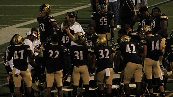 Lions+defense+huddled+together+on+Sept.+7+against+Northeastern+State.%0A%0APhoto+by+Lindsay+Fiala