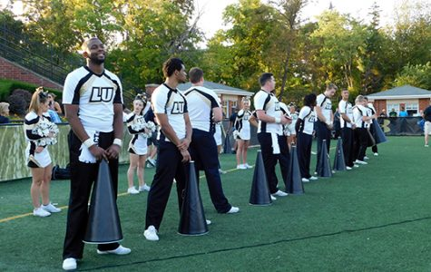 Members of the Lindenwood cheerleading team on the sideline during the Lions' home game against Washburn University on Sept. 16.  <br> Photo by Kat Owens </br>