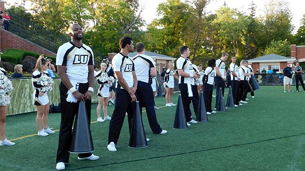 Members of the Lindenwood cheerleading team on the sideline during the Lions' home game against Washburn University on Sept. 16.   Photo by Kat Owens