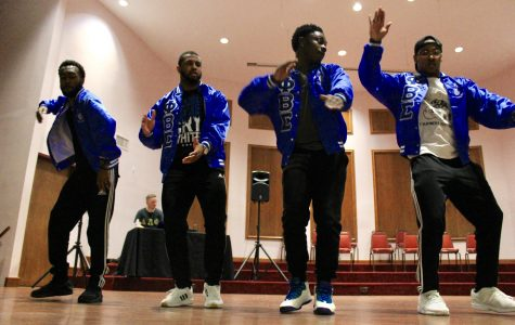Phi Beta Sigma performs a stroll at the Lindenwood Greek Yard Show on Oct. 13 during Homecoming week in the LUCC building. From left: Lamar Merriweather, Ira Hughes, Charles McGill and Jesse Dean. <br> Photo by Lindsey Fiala