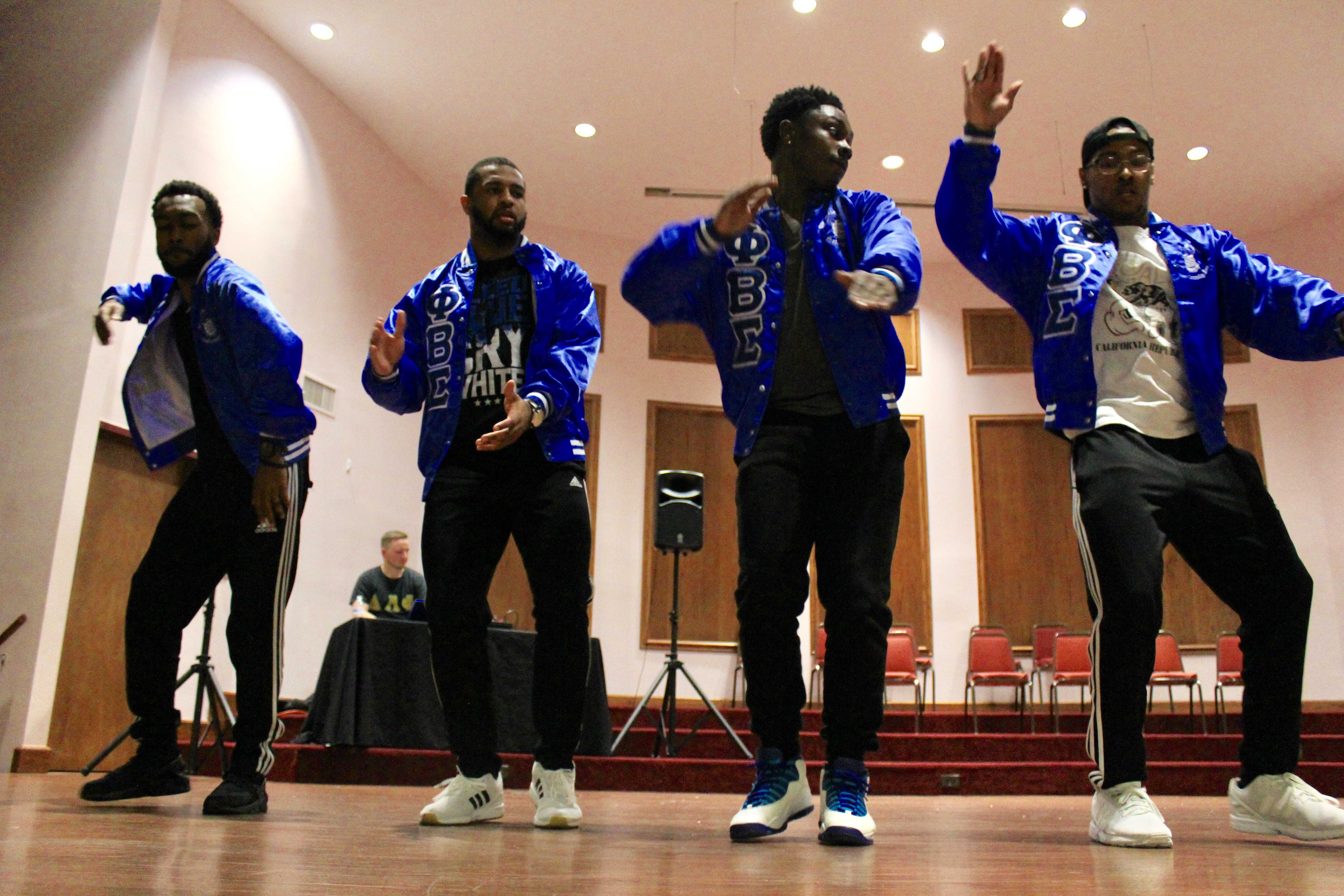 Phi Beta Sigma performs a stroll at the Lindenwood Greek Yard Show on Oct. 13 during Homecoming week in the LUCC building. From left: Lamar Merriweather, Ira Hughes, Charles McGill and Jesse Dean.  Photo by Lindsey Fiala