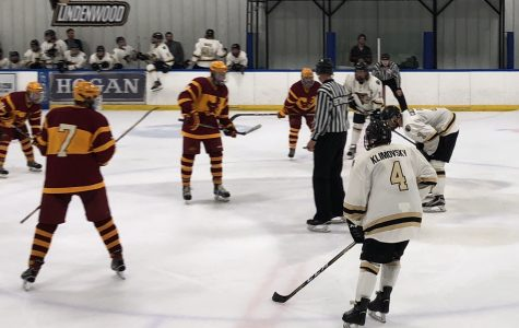Sophomore forward Jordan Klimovsky, No. 4, faces off against Iowa State University last Saturday Oct. 14, at the Wentzville Ice Arena. Klimovsky had one goal and an assist against the University of Oklahoma when the teams met last.   Photo by Madeline Raineri