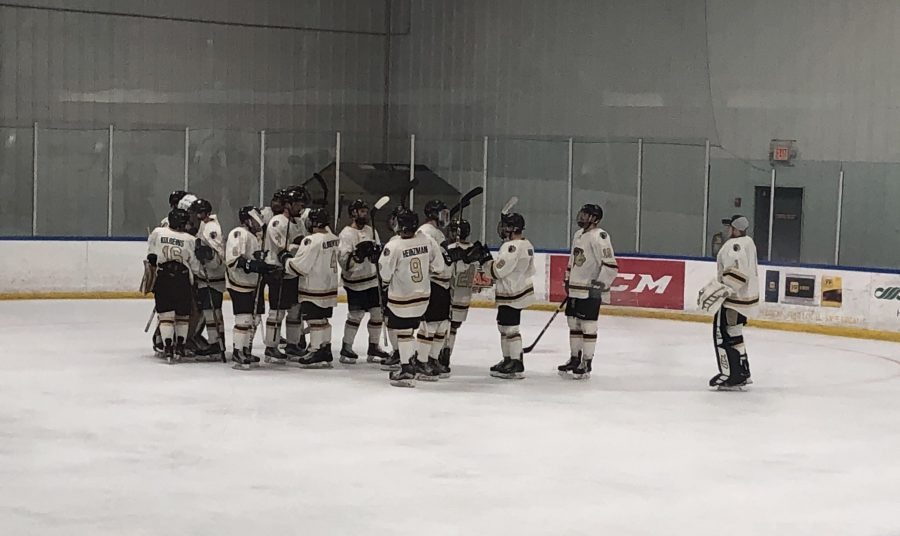 Lindenwood Lions hockey celebrates their third win in a row against the University of Oklahoma at home at the Wentzville Ice Arena last weekend on Oct. 21. Number 9, forward Tommy Heinzman, had two assists in one goal during their match up.  Photo by Madeline Raineri.