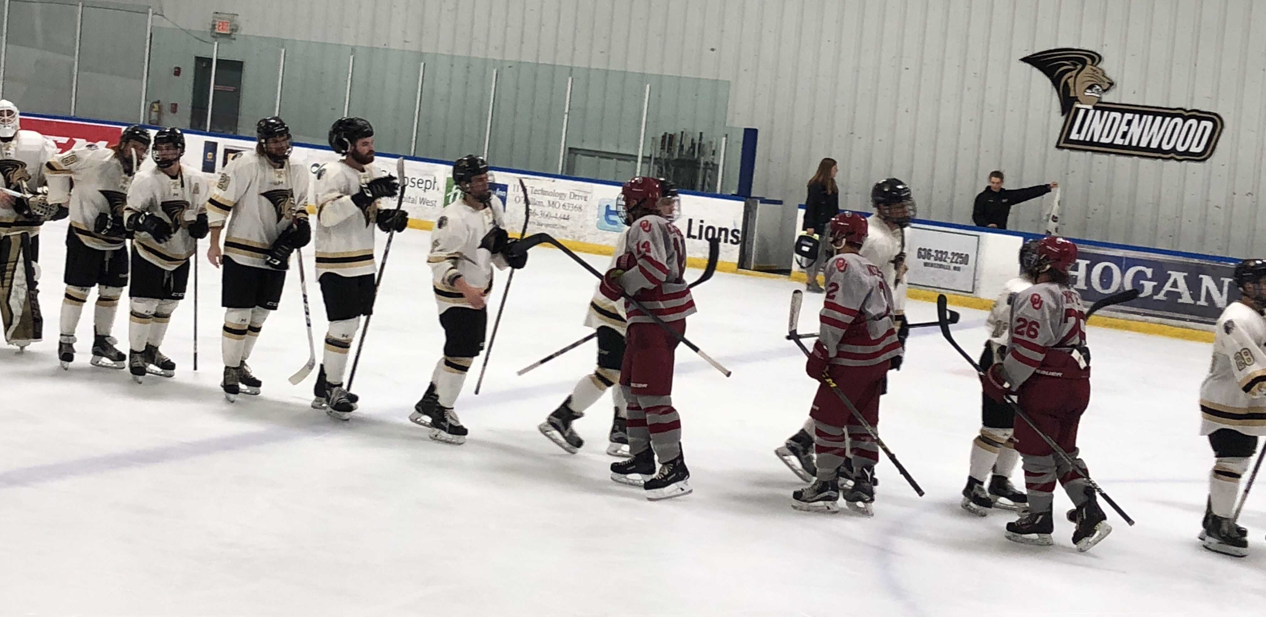 The Lindenwood Lions shake hands with the University of Oklahoma Sooners after their weekend sweep at the Wentzville Ice Arena. The Lions won both games, the first game 4-1 and the second game 8-0.  Photo by Madeline Raineri.