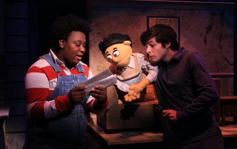 Carleeka N'joi Kimmins as land lord Gary Coleman and Jake Blonstein as Princeton at a dress rehearsal on Sept. 30 in the Emerson Black Box Theater. In this scene they look at Princeton's bills that he needs to pay. <br> Photo by Lindsey Fiala