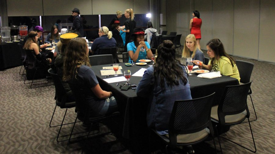 Students enjoy their appetizers as they wait for the murder mystery to begin.  Photo by Lindsey Fiala
