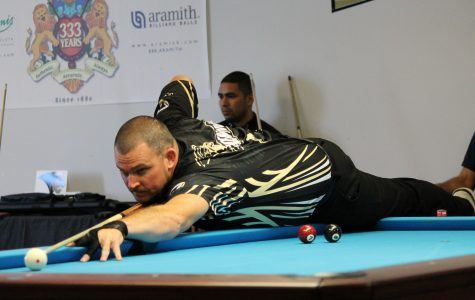 Brandon Jordan stretches across the table during the first set of his two win tournament.  <br>Photo by Walker Van Wey </br>