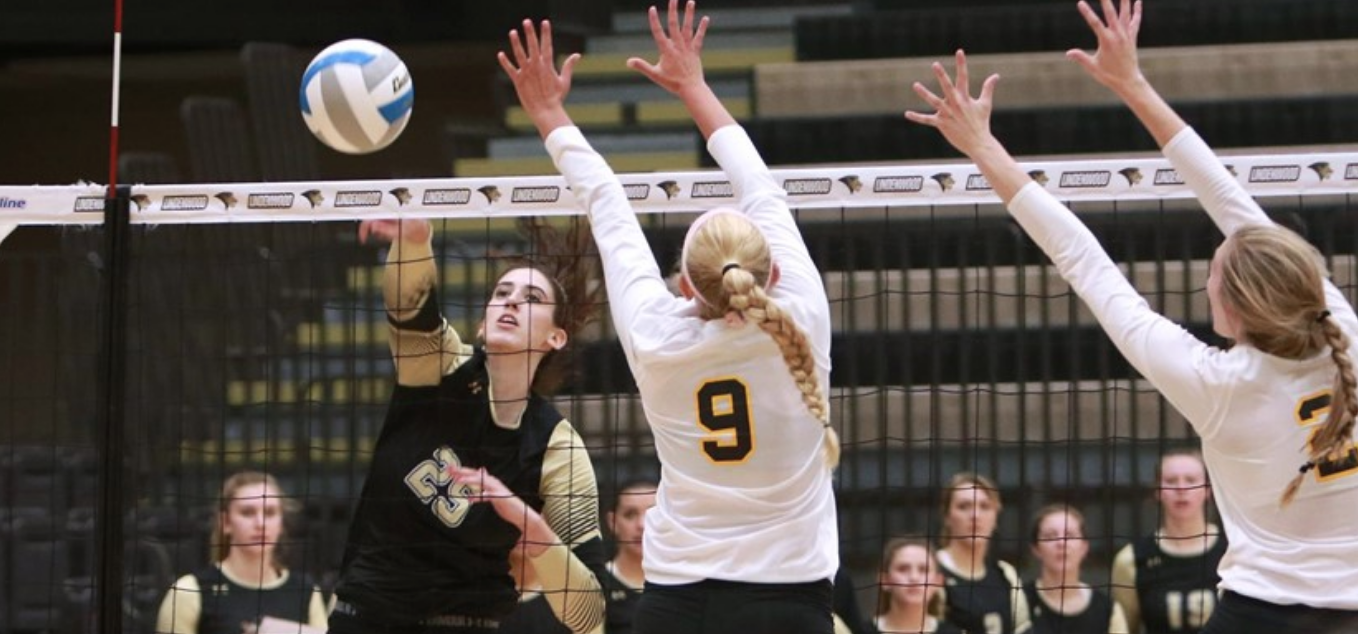 Women's volleyball player Emily Wylie spikes the ball. The senior currently leads the Lions in kills this season. Wylie transferred from Armstrong State this semester.  Photo by Lindenwood Athletics