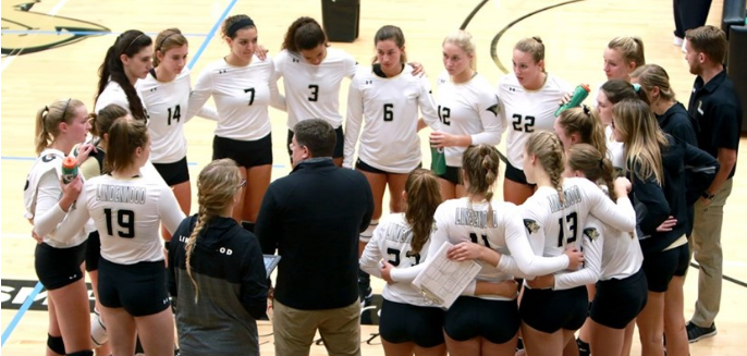 The Lindenwood women's volleyball team gathers to listen to head coach Will Condon give instructions in Hyland Arena. Photo by Don Adams Jr.