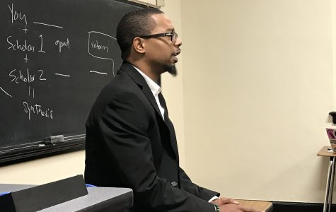 Tarrell Campbell talking to his Research & Argumentation class about an upcoming assignment. Campbell is this year's winner of the St. Louis University Walter J. Ong Award for Excellence in Graduate Research. <br> Photo by Megan Courtney