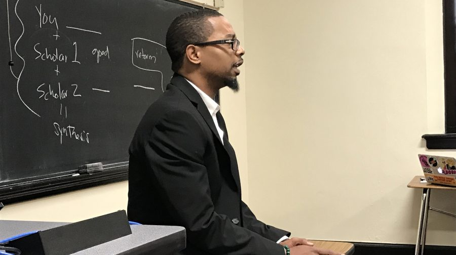Tarrell Campbell talking to his Research & Argumentation class about an upcoming assignment. Campbell is this year's winner of the St. Louis University Walter J. Ong Award for Excellence in Graduate Research.  Photo by Megan Courtney