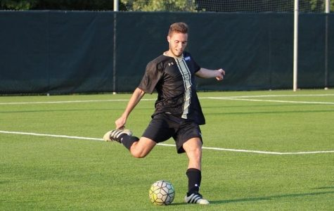 Gaspar Alvarez, No. 5, strikes the ball in a 4-2 loss to Harding University back on Oct. 20. <br> Photo by Lindenwood Athletics.