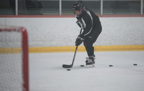 This file photo shows Freshman Dom Kolbeins skating up the ice towards the net with the puck during practice on Friday, September 30th. <br> Photo by Mitch Kraus