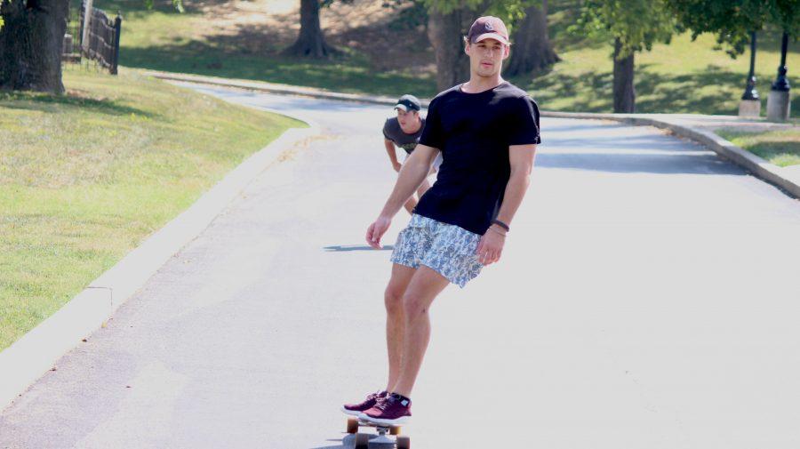 Junior+Chris+Kelland+boards+down+the+training+hill+next+Hunter+Stadium.+Photo+by+Kyle+Rainey